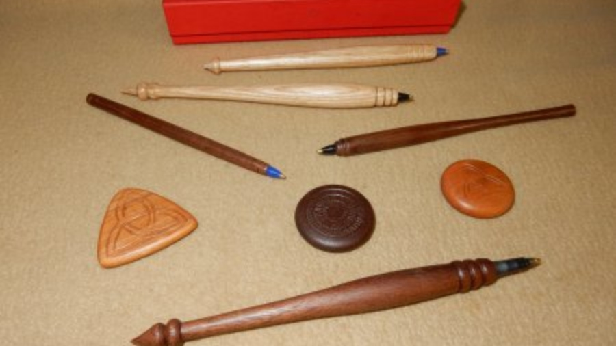 Show & Tell stick pens and medallions by Phil Royer